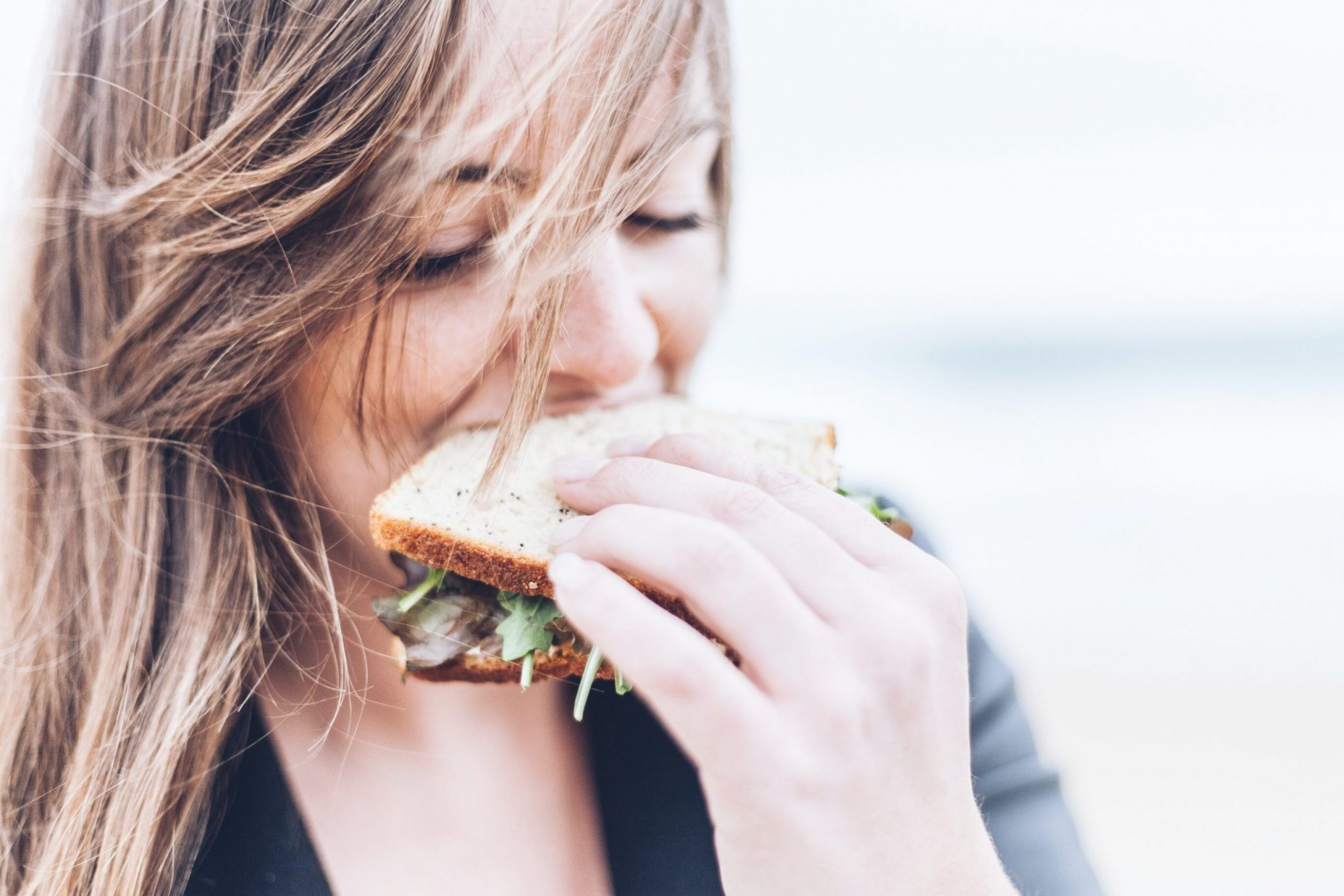 nutrition to live | girl eating sandwich